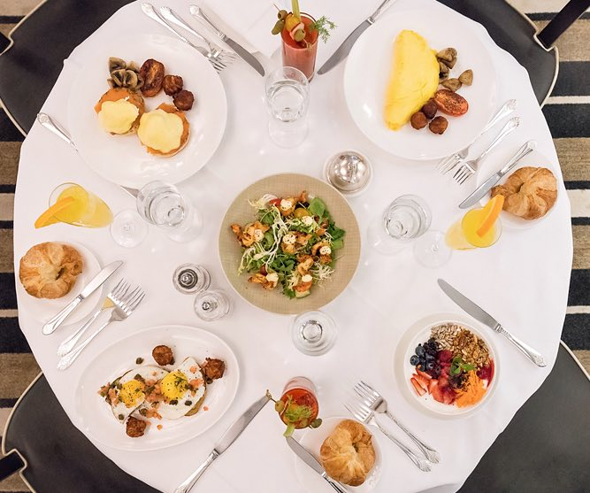 Overhead shot of plate set for four wish colorful dishes