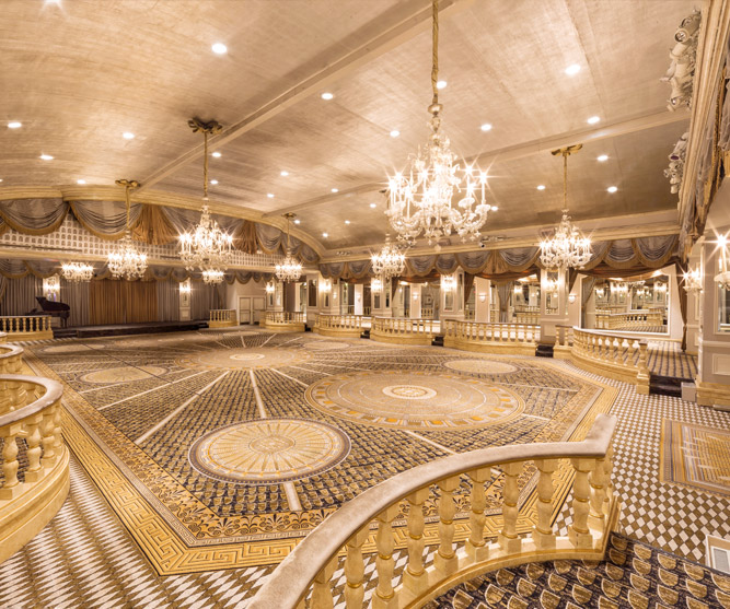 Large empty ballroom with several chandeliers