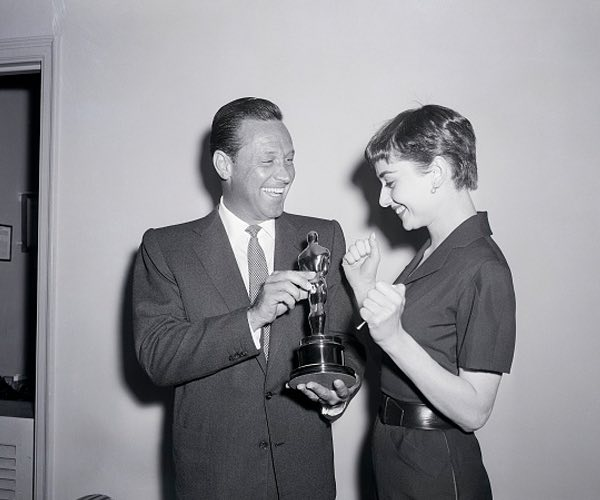 Old image of man handing woman award