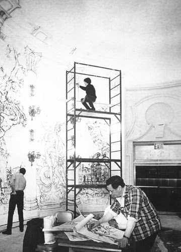 Old image of murals being painted