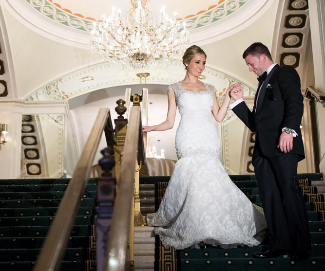 bride and groom descending stair case
