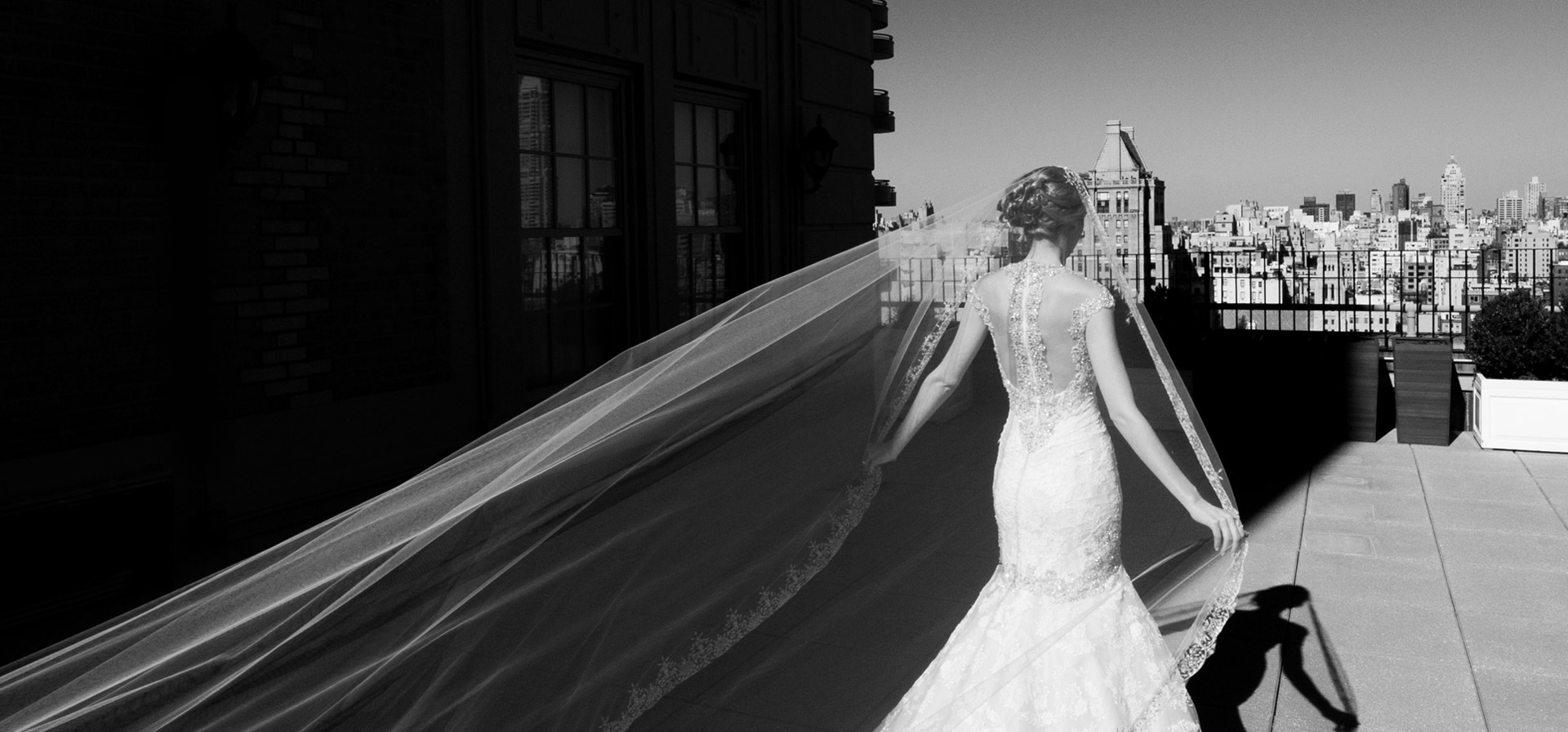 Bride walking on hotel terrace