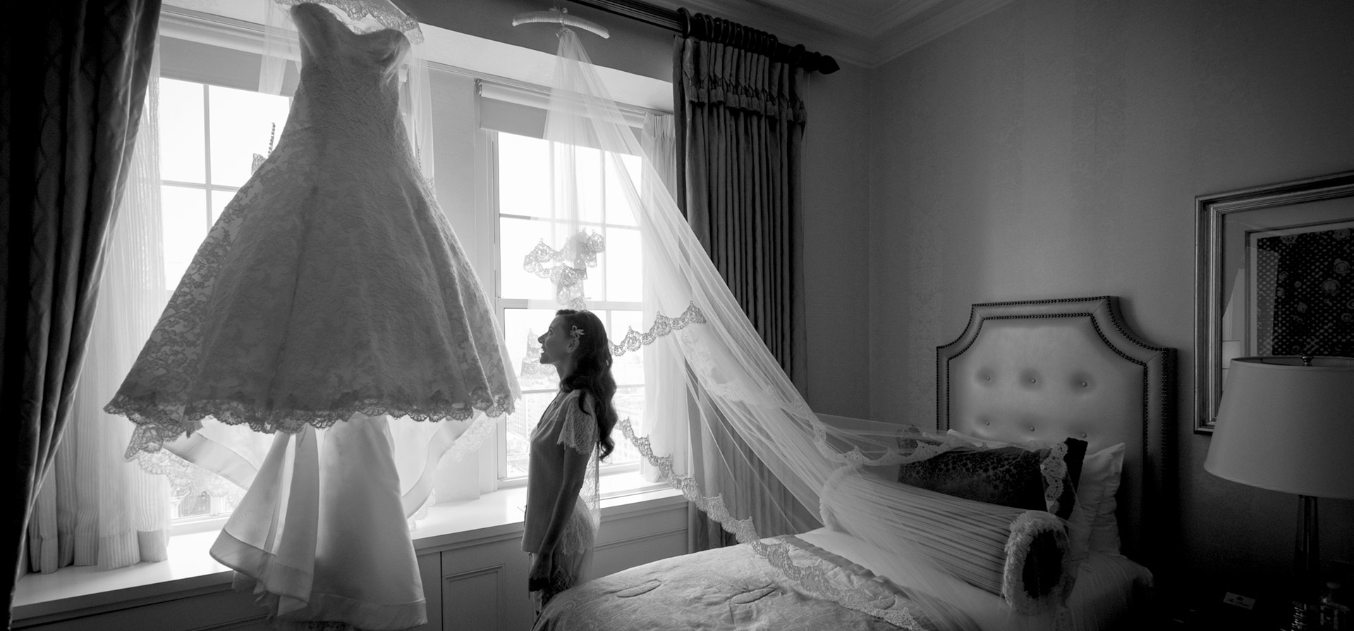 Woman in room next to wedding dress
