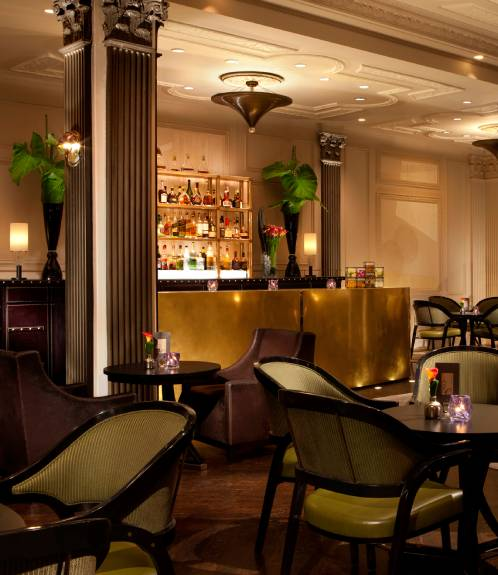waiter serving pastries and tea