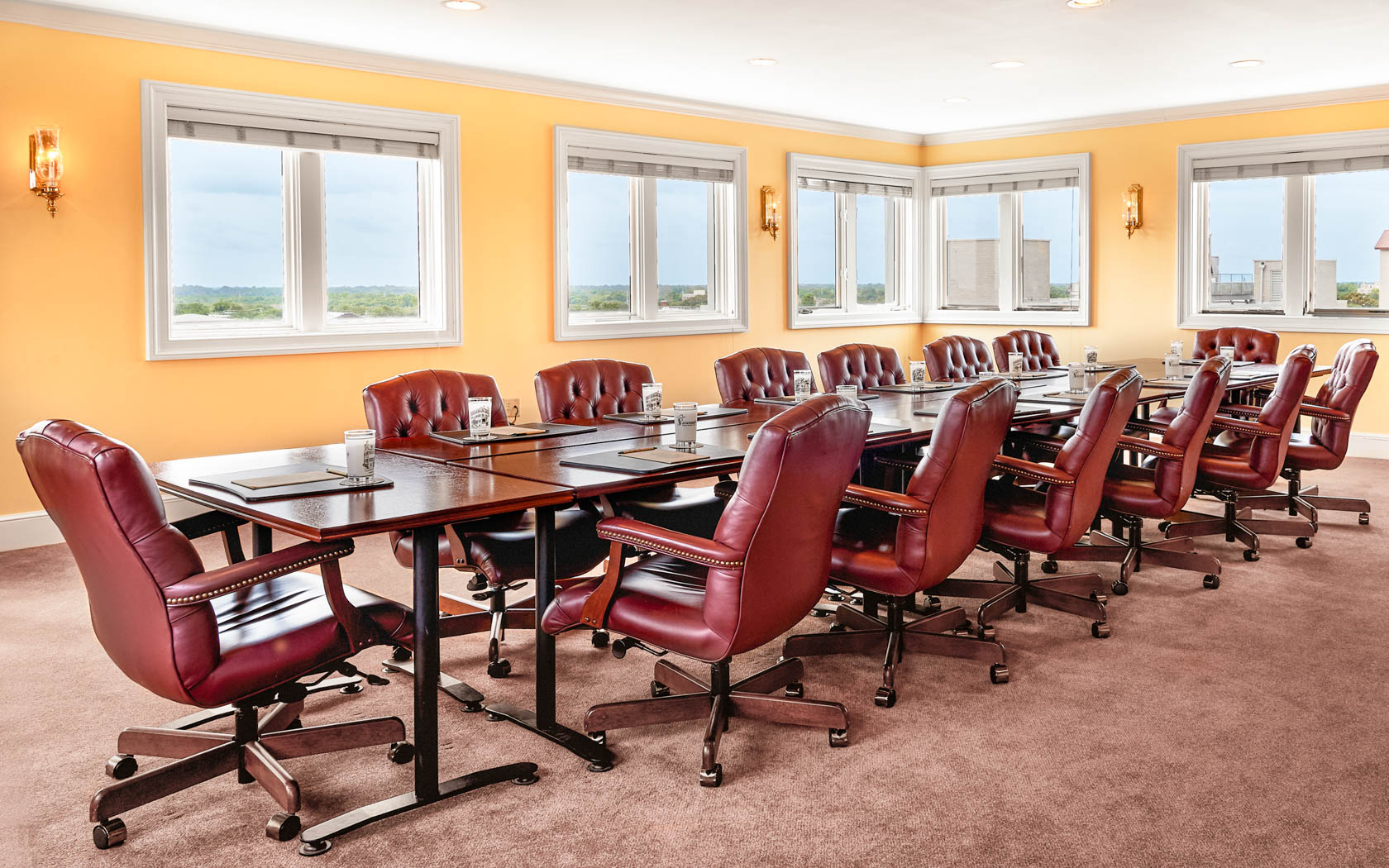 boardroom with long table and chairs surrounding