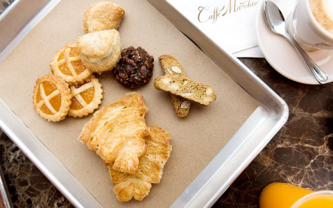 a metal tray of small assorted pastry items