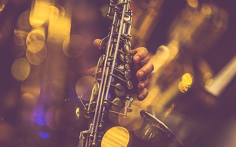 a person playing the saxophone