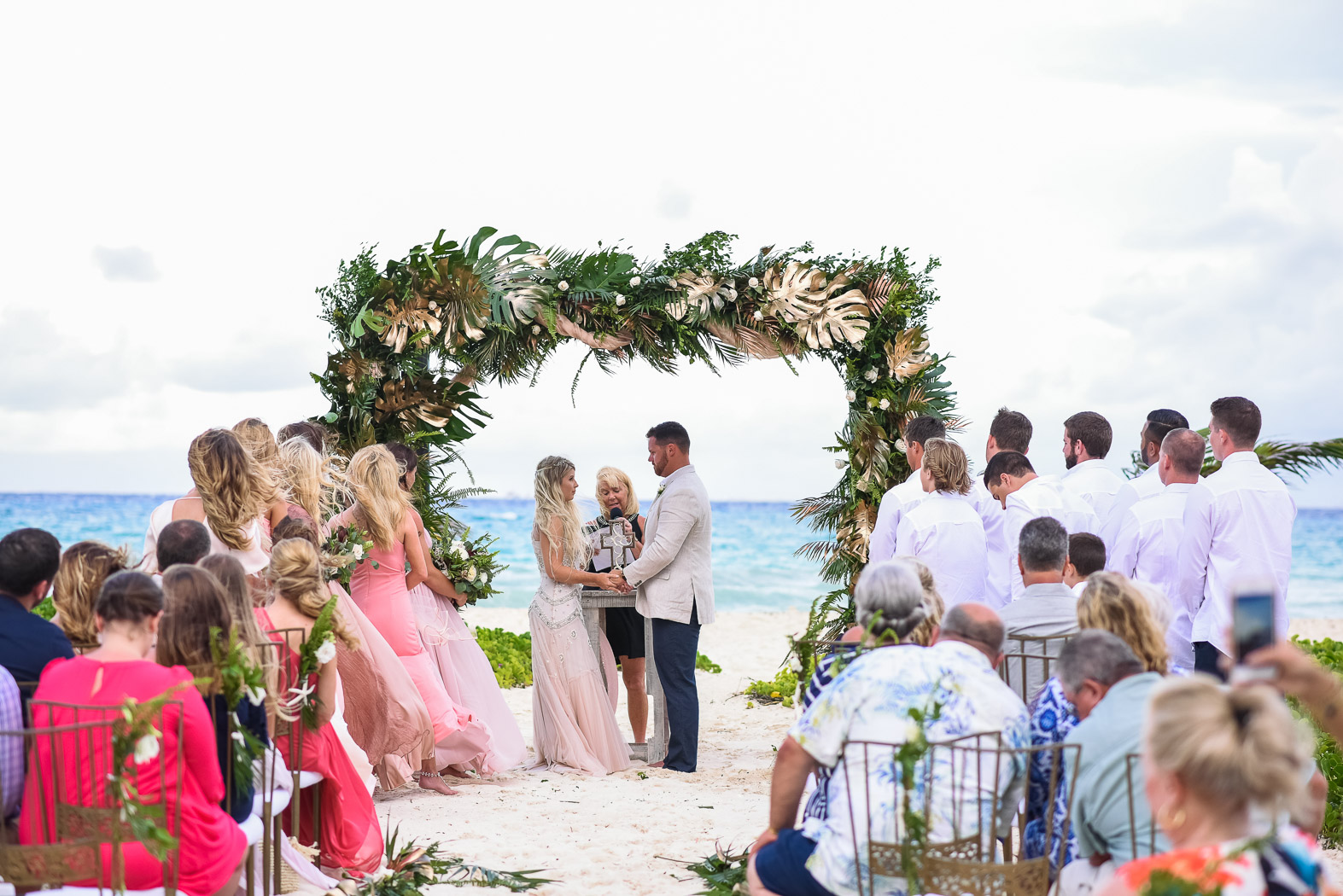 a couple getting married on the beach