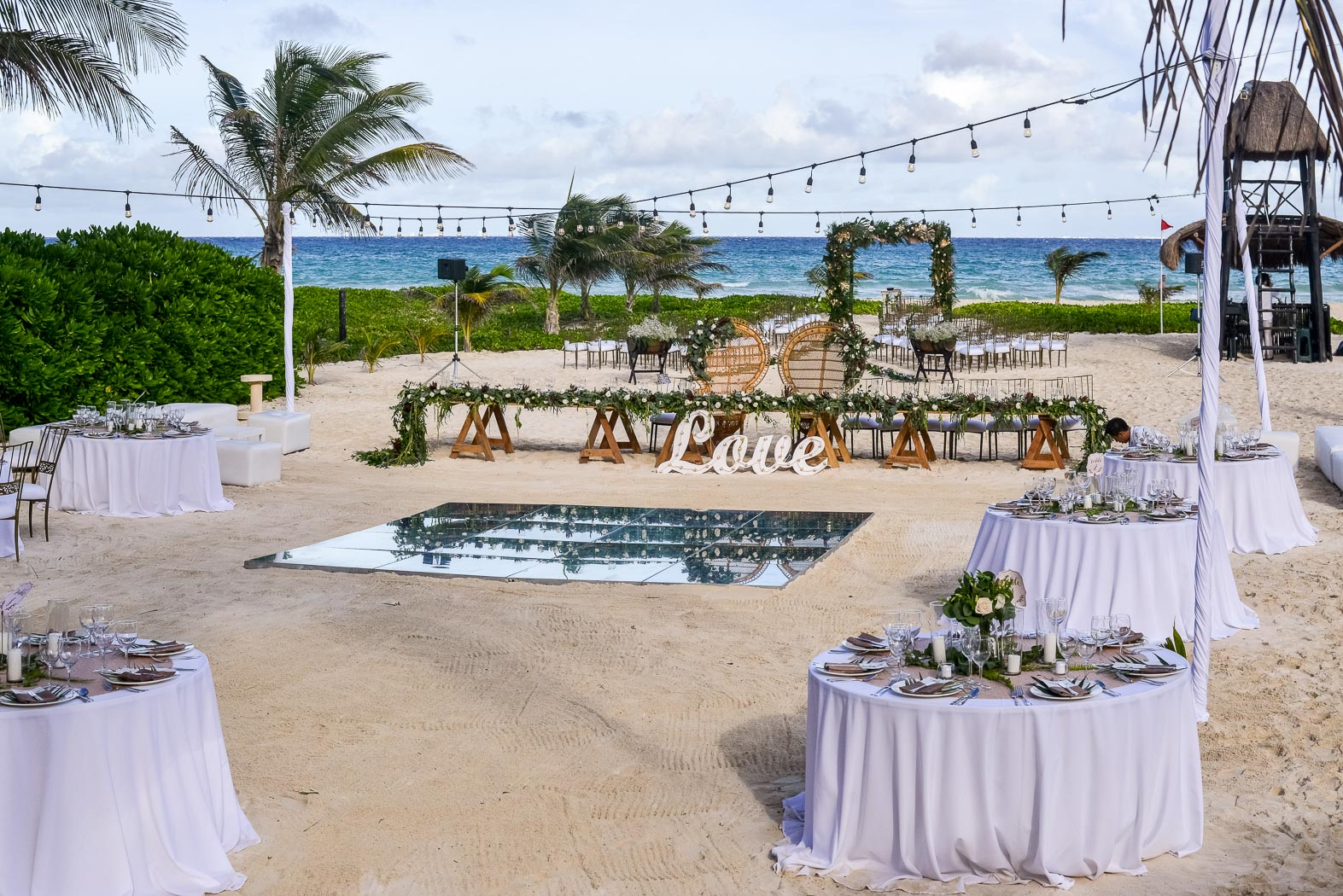Overview of set up for wedding outside on the beach