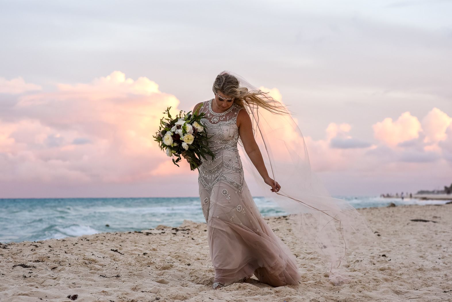 a bride on the beach at sunset