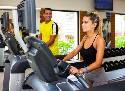 Man and woman exercising at fitness center