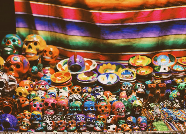 Colorful Day of the Dead skulls at market stall