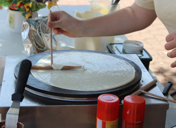 Crepe being prepared on a hot press