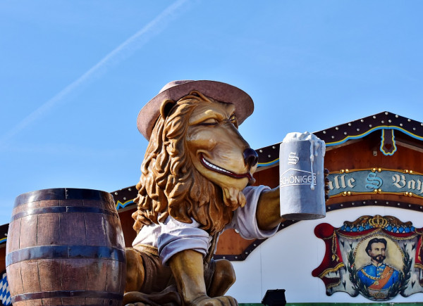 Oktoberfest lion statue with large beer mug