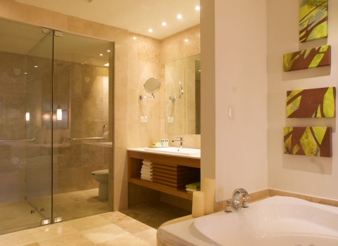 Bathroom with all glass shower and tile floors