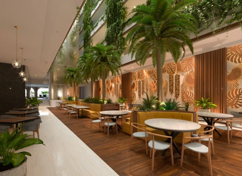 Restaurant that has circle white tables and wood floors with palm trees around