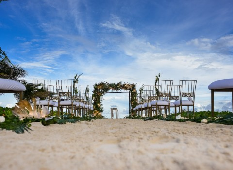 outside on the beach set up for a wedding