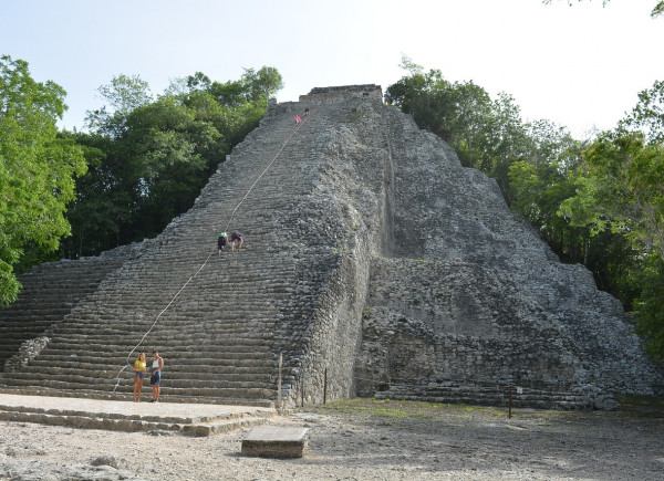 Tourists climbing Mayan pyramid at Coba