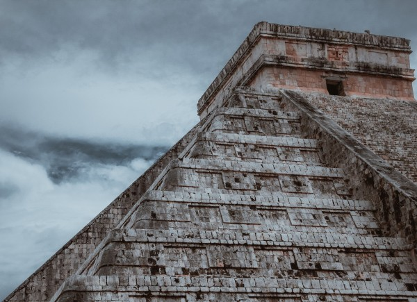 Upper portion of Mayan pyramid at Coba against cloudy grey sky