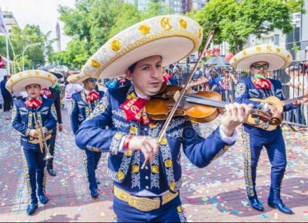 mariachi band in blue outfits