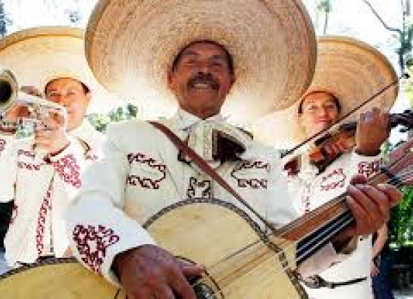 mariachi band in white costume
