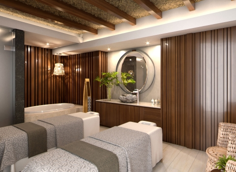 Two spa bedswith grey blankets and wood panel walls