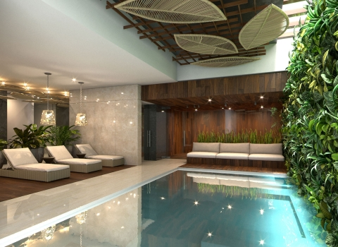 Large indoor pool with wine wall beside it