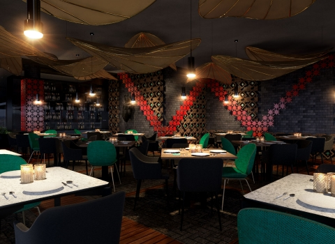Dark lit restaurant with dark green chairs and red walls