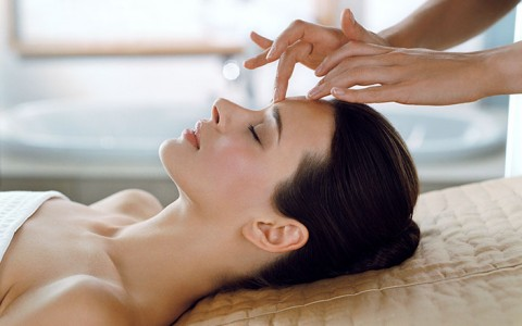 Woman receiving relaxing spa facial