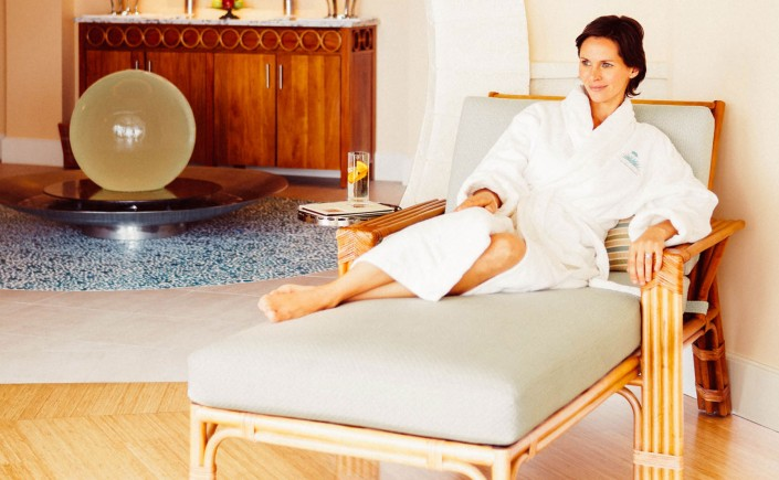 woman in robe on lounge chair waiting for her spa treatment