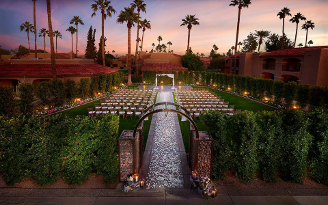 aerial view of wedding arch with gravel path during sunset