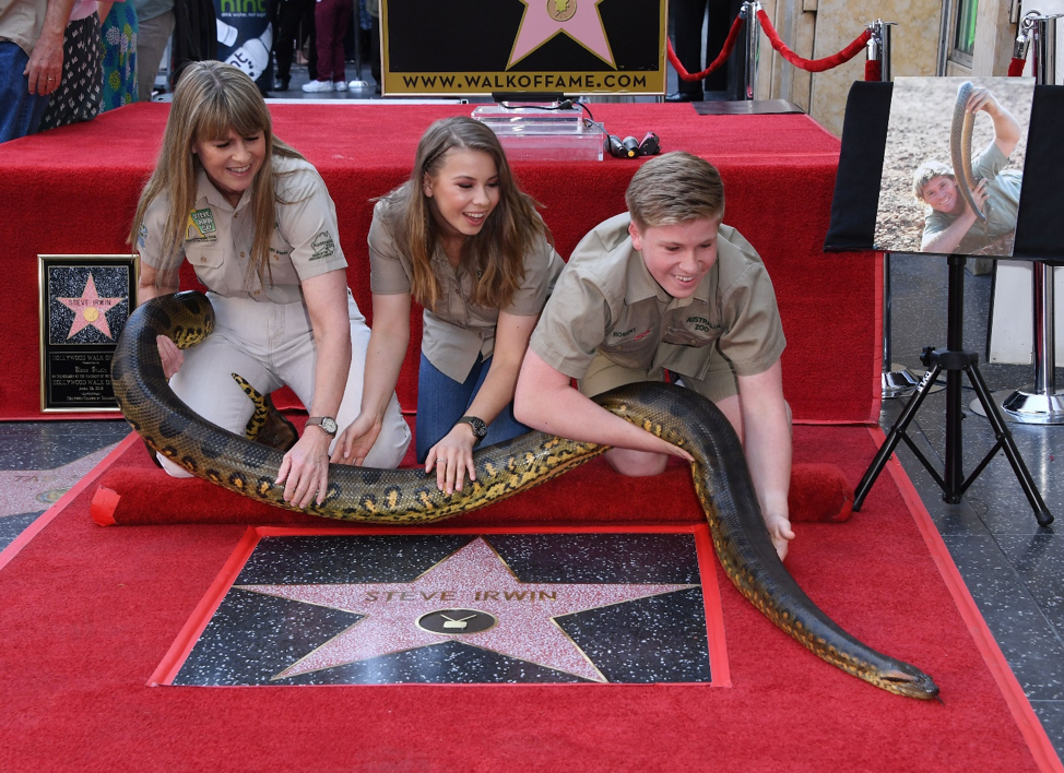 family holding snake at hollywood walk of fame