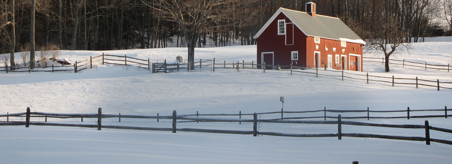 Red barn house and winter snow