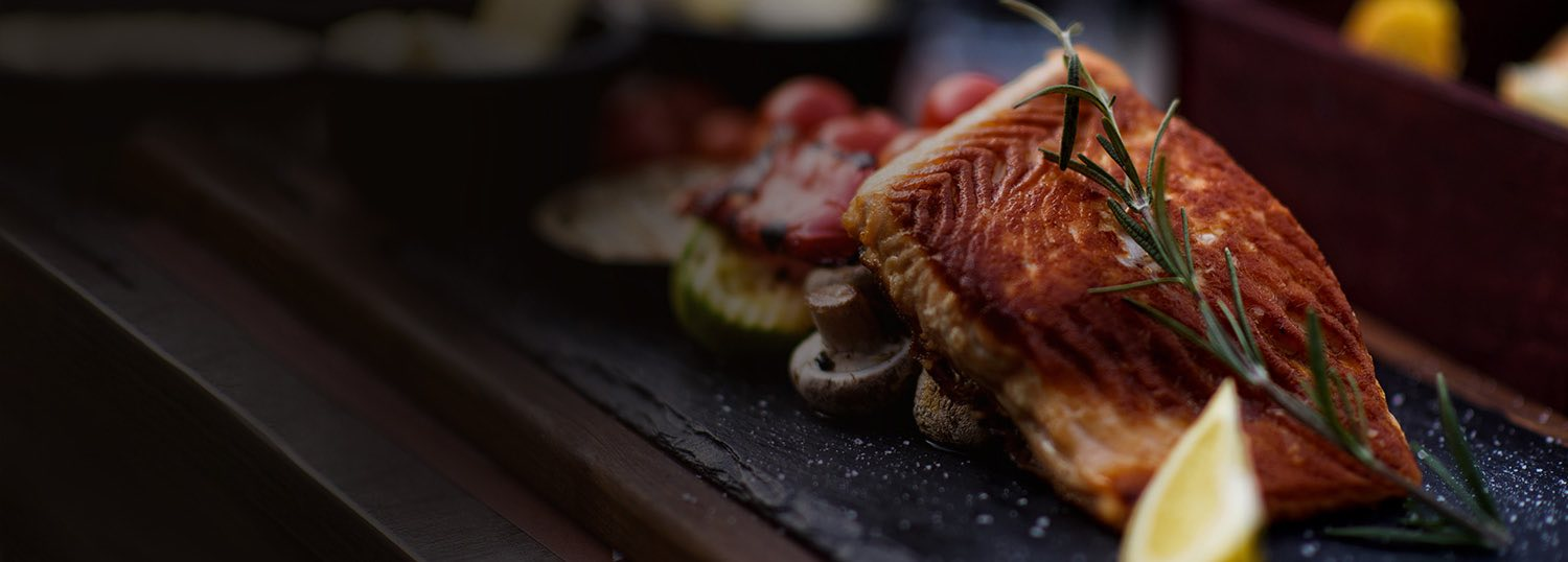 Grilled fish on vegetables