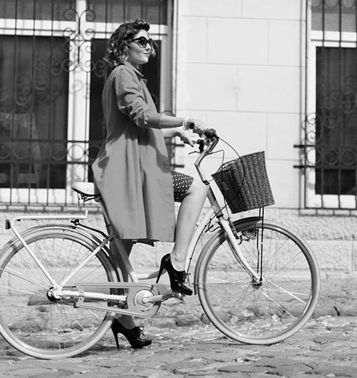 vintage girl riding a bike