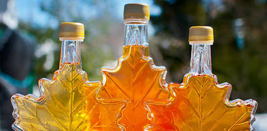 maple syrup in maple leaf shaped container