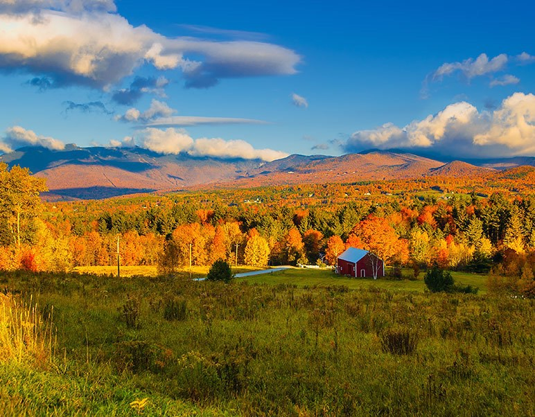 vermont mountains in the fall with a blue sky