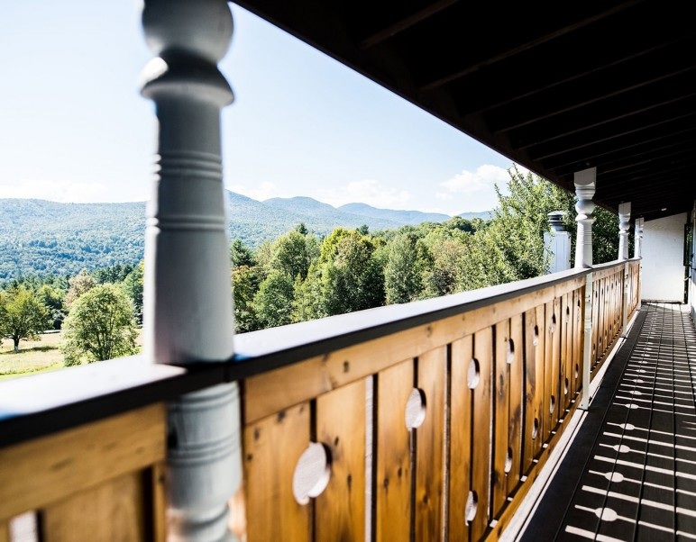wooden balcony view with mountain view