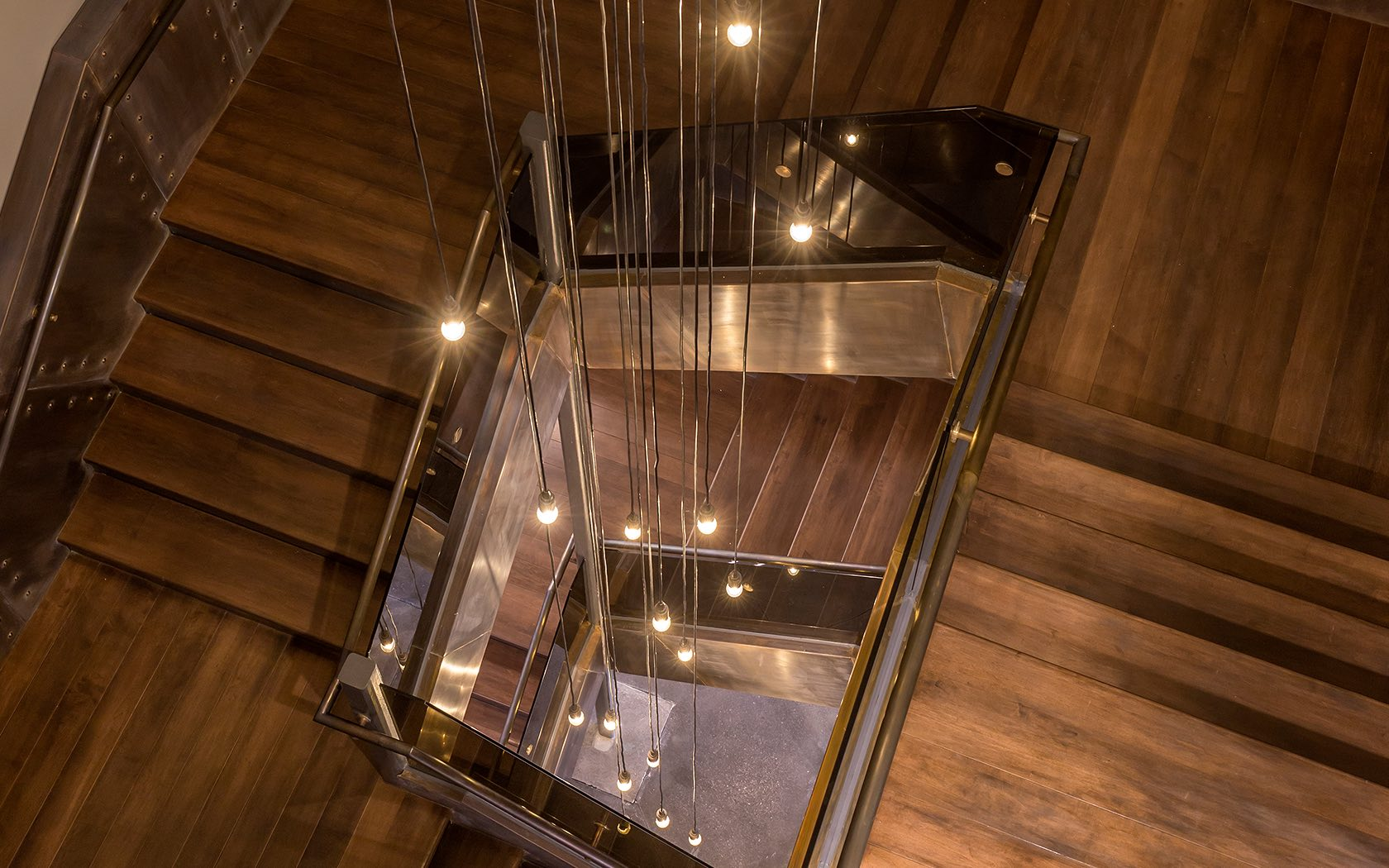 Spiral staircase with draping lights