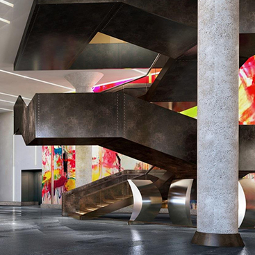 Geometric bronze staircase with colorful modern art in the back