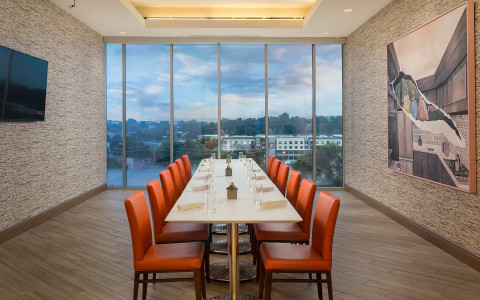 Private dining room with large windows overlooking the city