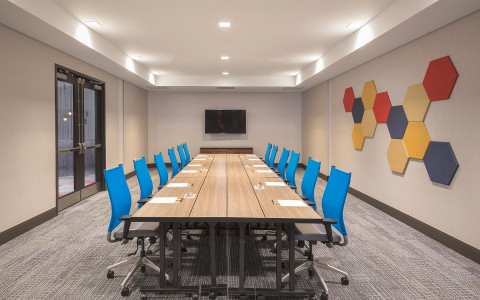 Conference room with geometric artwork on the walls