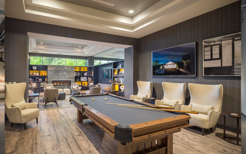 Pool table and library lounge at The Summit