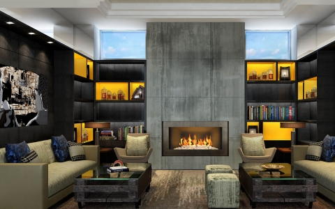 A library nook with floor-to-ceiling fireplace