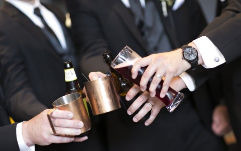 Photo credit to Dan Kinzie, groomsmen toasting to a wedding