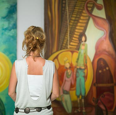 Woman standing in front of artwork