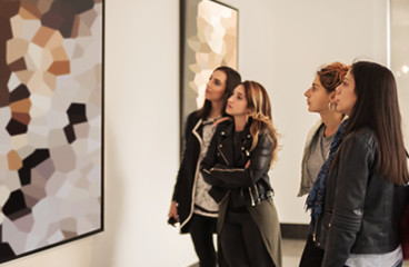 Women looking at artwork in museum