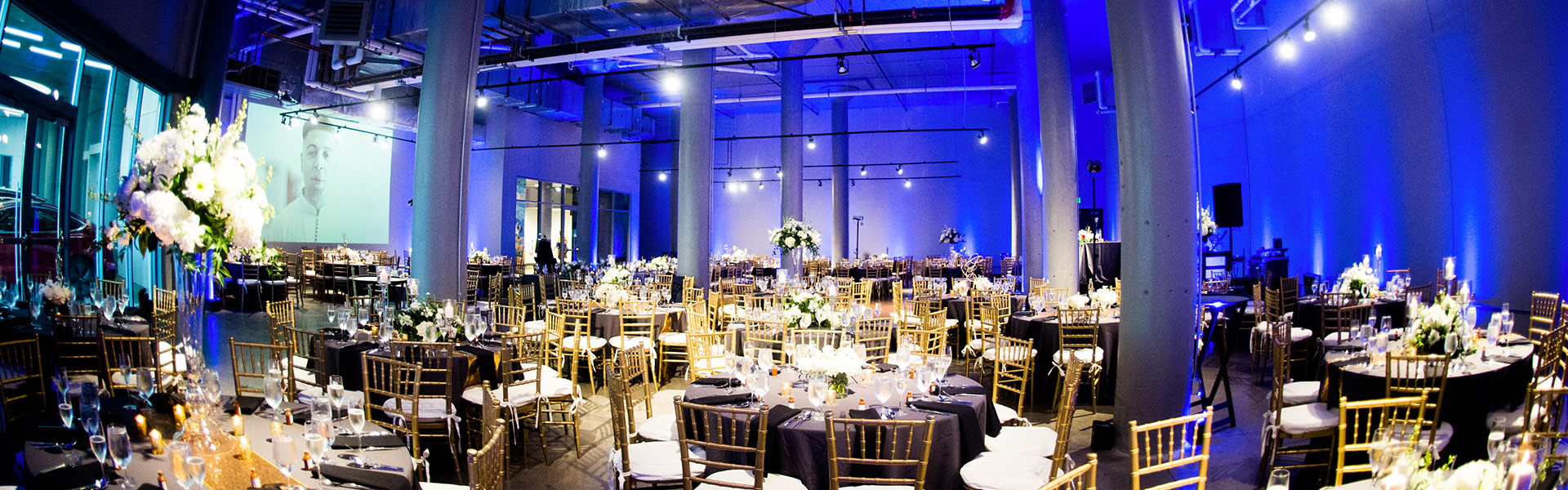 big open venue decorated for wedding