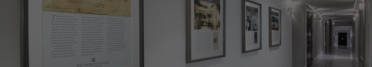 wide header image of hallway with framed documents
