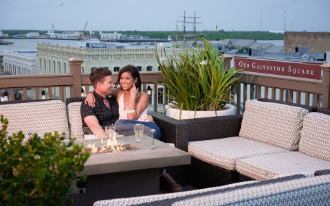 couple enjoying cocktails on rooftop